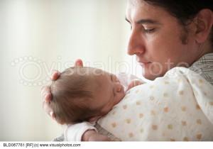 Hispanic father holding newborn baby girl