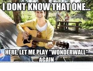 Guy playing guitar lame