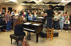 Christmas Choir Rehearsal Choir begins rehearsing