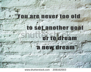 ... motivating quote on pastel block brick wall - stock photo