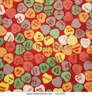 Large group of colorful candy hearts with sayings on them arranged on ...