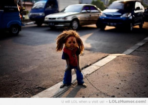 ... of nightmares: Monkey wearing Cabbage Patch Doll mask with dreadlocks