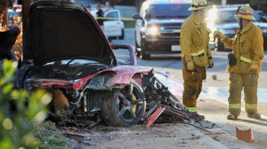 The red Porsche crashed into a lamp post in Valencia, north of Los ...