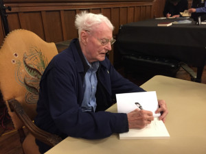 Robert Bly autographs books on Monday night