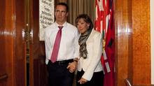 Ontario Premier Dalton McGuinty, left, walks out of the government ...