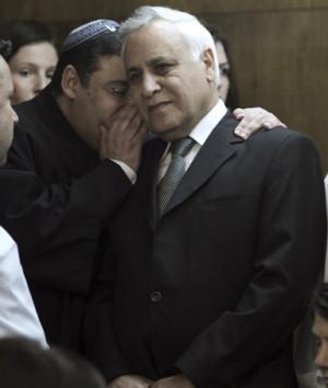 Israel's former President, Moshe Katsav, (C) is seen inside the Tel ...