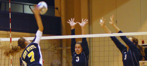 Outside Hitter Maigan Larsen spikes the ball. Photo by Sam Verblecz.