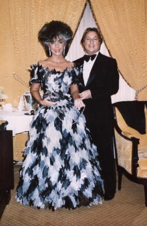 Designer Arnold Scassi with actress Elizabeth Taylor. Arnold Scaasi ...