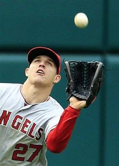 Angeles Angels' Mike Trout catches a fly ball hit by Cleveland Indians ...