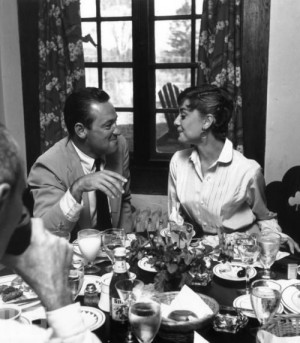 American actor William Holden and Hepburn smile at each other during a ...