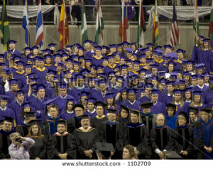 college graduation crowd with one member wearing funny nose glasses