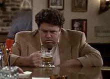 Norm Peterson ( George Wendt ) drinking beer