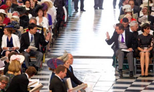 Ed Miliband and David Cameron acknowledge each other at the service of ...