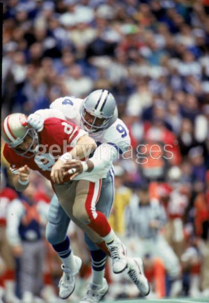 Charles Haley hits Steve Young during the 1993 NFC Championship Game.