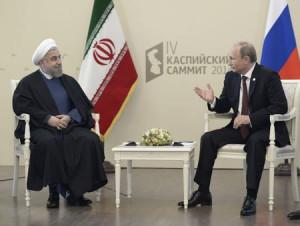 Vladimir Putin (R) talks with his Iranian counterpart Hassan Rouhani ...