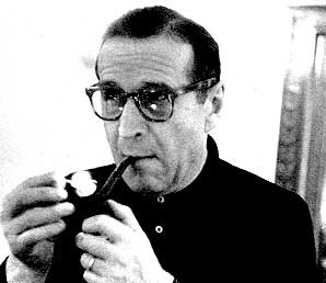 Lighting one of his 46 pipes Simenon ponders new Maigret book he was