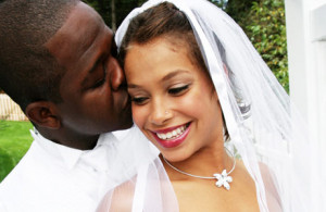 African American Groom Kissing Bride