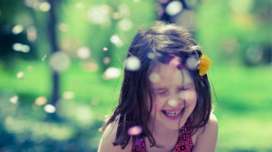 Download high quality 1600 x 900 A little happy girl Wallpaper.