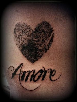 ... the child's name underneath amore thumb prints (his and her tattoo