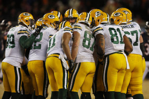 Green Bay Packers huddle before a play against the Chicago Bears ...