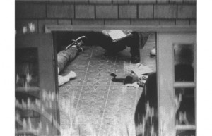 Special investigators examine the body of Kurt Cobain, which lies on ...