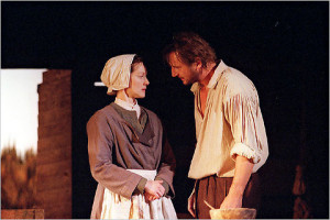 Liam Neesan as John Proctor and Laura Linney as his wife Elizabeth on ...