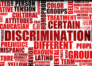 This is a photo of a collage showing words related to prejudice.
