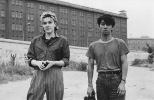 David Sylvian and Ryuichi Sakamoto in front of the Berlin Wall during ...