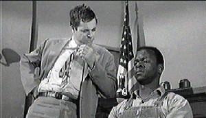 Mr. Gilmer cross-examining Tom Robinson