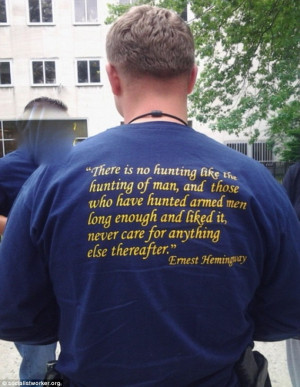 officers can be seen wearing t-shirts with a Ernest Hemingway quote ...