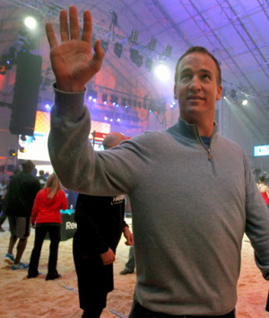 Indianapolis Colts quarterback Peyton Manning waves to the crowd as he ...