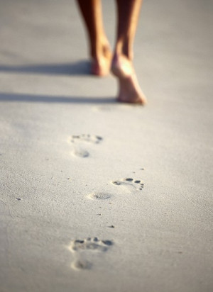 Footprints in the sand, barefoot, bare feet, beach, summer.