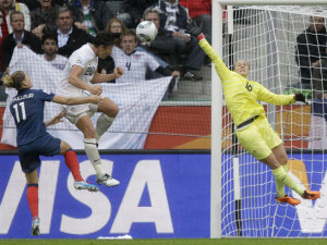 AP Abby Wambach scores the second goal of the match against France.