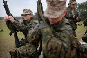 Female Marines shoot rifles and swim in uniform at boot camp
