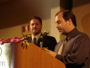 John Everson accepts the First Novel award from president Joe Nassise