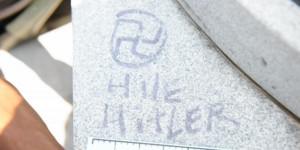 Jackie Robinson statue defaced with racist slurs, swastikas outside ...