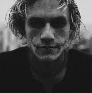 Heath Ledger wearing The Joker makeup black and white portrait