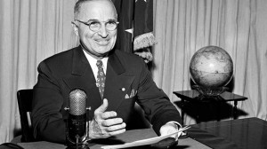 FILE Sept. 1, 1945: President Harry Truman sits before a microphone at ...