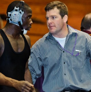 Tom Brands talks to Montell Marion at the 2011 Big Ten Championships ...