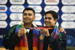 Gagan Narang, left, and Hasan Imran Khan smile with the gold medals ...