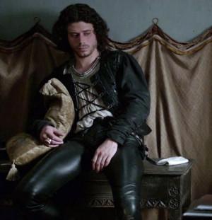 Cesare Borgia in Renaissance men's clothing.