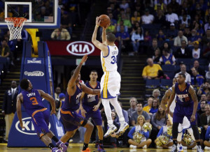 Stephen Curry puts up a three point shot in the second half. The ...