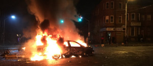 Car burning in Baltimore riots (Source: Casey Harper)