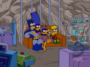 ... . Homer is dressed as Batman and Bart as the Boy Wonder, Robin
