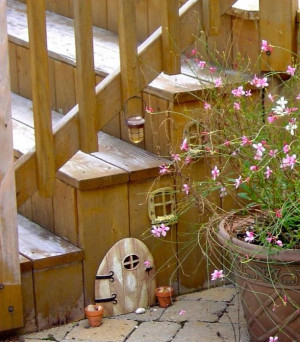 not into Fairy Gardens, but this would be very cute for the deck ...