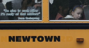 Students sit behind a quote by slain Sandy Hook Elementary School ...