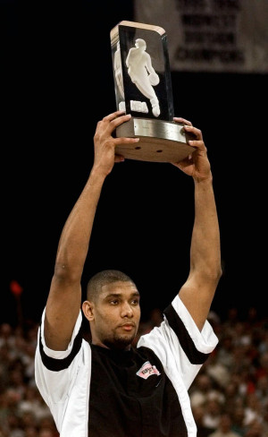 San Antonio Spurs forward Tim Duncan holds up his NBA Rookie of the ...