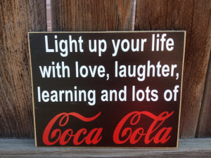 Coke wood sign-- Light up your life quote