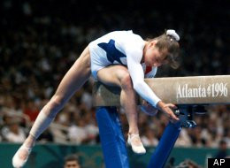 Dominique Moceanu takes a fall at the 1996 Summer Olympics
