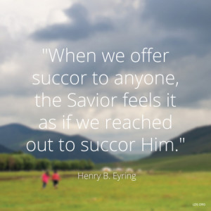 field with mountains beyond and a quote by President Henry B. Eyring ...